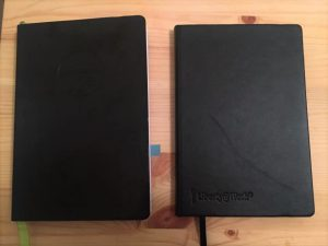 Passion Planner on the left, black book of secrets on the right (journal).